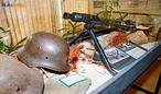 Capacete e metralhadora nazista utilizados na Segunda Guerra Mundial, exemplares expostos no Museu do Expedicion�rio em Curitiba - Paran�. <br><br/> Palavras-chave: rela��es de poder, For�as Armadas, Ex�rcito Brasileiro, For�a Expedicion�ria Brasileira, armas, Museu do Expedicion�rio, Curitiba, Paran�.