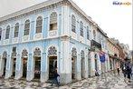 Casa Edith, localizada na Pra�a Generoso Marques em Curitiba. O pr�dio foi constru�do em 1879. <br><br/> Palavras-chave: Rela��es culturais, patrim�nio hist�rico, com�rcio urbano, Pra�a Generoso Marques, Curitiba, Paran�.